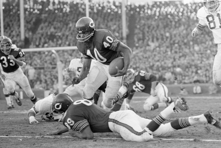Chicago Bears RB Gale Sayers finds an open spot and leaps over teammate Bob Wallace (89) in a 1969 game against the Cleveland