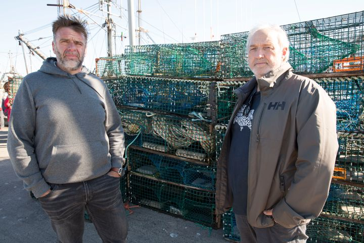 Colin Sproul, President of the Bay of Fundy Inshore Fishermen's Association, left, and Bernie Berry, President of the Cold Water Lobster Coalition, posed in front of Mi'kmaw lobster traps they seized in Saulnierville, N.S. on Sept. 20, 2020.
