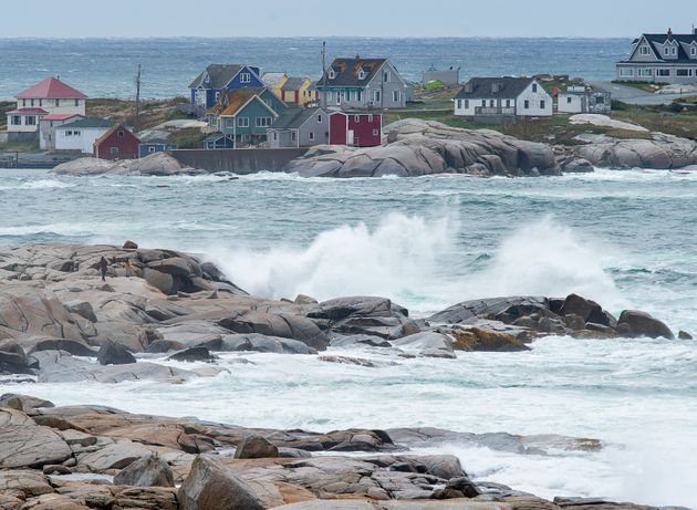 Waves batter the shore in Peggy's Cove, N.S., on Wednesday. Residents living in the area have been asked...