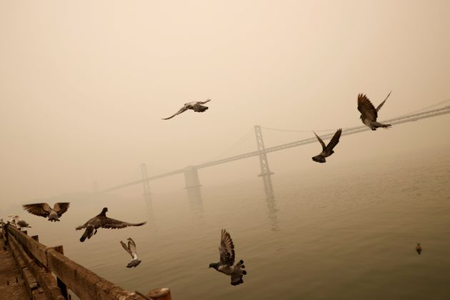 The San Francisco-Oakland Bay Bridge is seen under a smoke-filled sky due to various California wildfires...