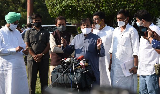 Congress MP Ahmed Patel, with other MPs, addresses the media after the passing of two farm bills in Rajya...