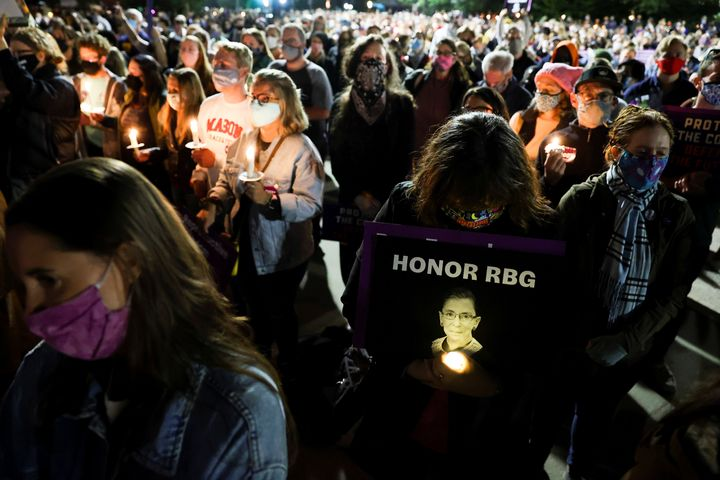 People gather outside the U.S. Supreme Court for a vigil Saturday following the death of Supreme Court Justice Ruth Bader Gin