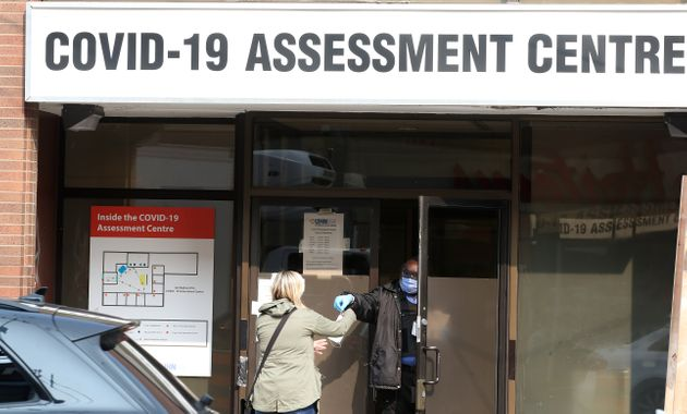 A lineup of 150 people to get a test at the Toronto Western Hospital COVID-19 Assessment Centre on Sept....