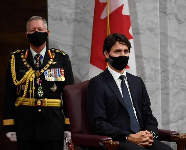 Chief of Defence Staff Jonathan Vance, left, and Prime Minister Justin Trudeau listen to Gov. Gen. Julie Payette deliver the throne speech in the Senate chamber in Ottawa on Wednesday.