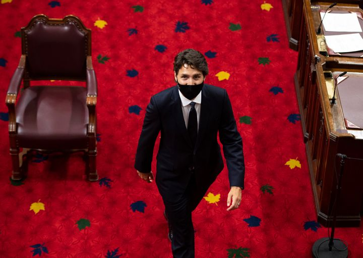 Prime Minister Justin Trudeau heads back to his seat before the delivery of the throne speech at the Senate of Canada Building in Ottawa, on Sept. 23, 2020.