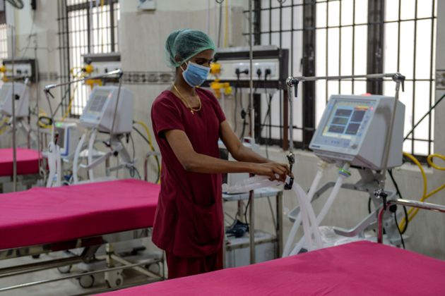 A medical staff checks on a ventilator of an intensive care unit at a newly inaugurated