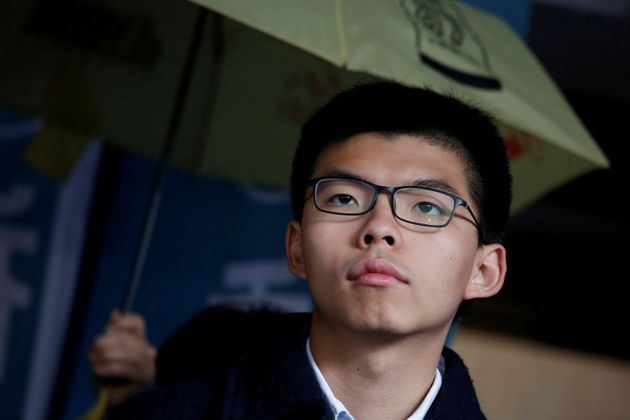 Former student leader Joshua Wong reacts outside High Court before receiving his sentence in Hong Kong,...