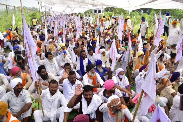 Farmers raise slogans during a protest at Beas Bridge against the three agriculture ordinances on September...
