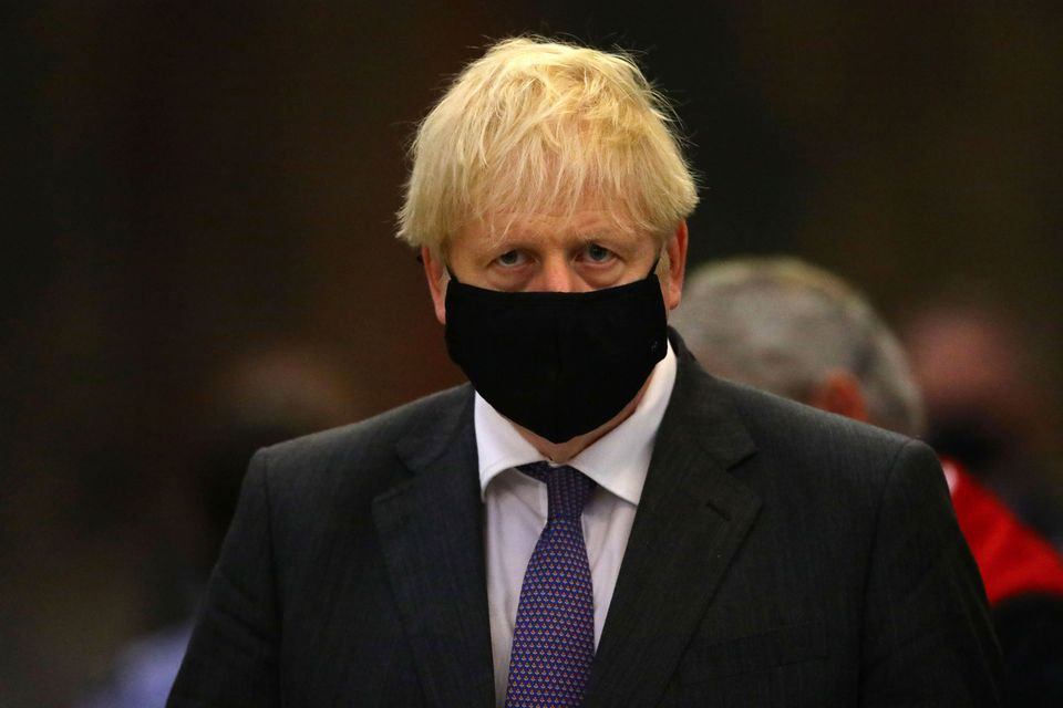 Prime Minister Boris Johnson wearing a protective face covering