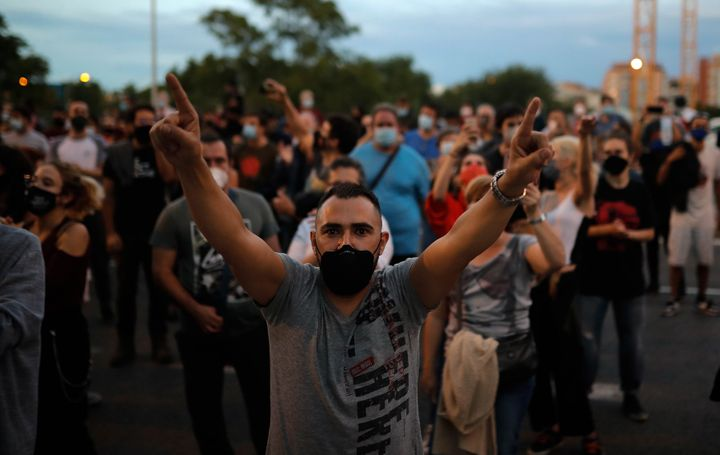 Protesters take part in a demonstration in the Vallecas neighborhood of Madrid against measures imposed by the Madrid regional government on areas with the most COVID-19 cases on Sept. 20.