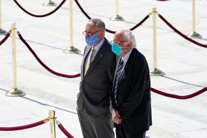 Sens. Chuck Schumer and Bernie Sanders pay their respects as the late Justice Ruth Bader Ginsburg lies in repose at the U.S.