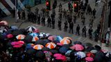 Protesters use umbrellas at the front line of a barricade guarded by Seattle police and the National Guard following the death in Minneapolis police custody of George Floyd, near the department's East Precinct in Seattle, Washington, U.S. June 3, 2020. REUTERS/Lindsey Wasson     TPX IMAGES OF THE DAY