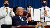 President Donald Trump holds up an executive order after delivering remarks on healthcare at Charlotte Douglas International Airport, Thursday, Sept. 24, 2020, in Charlotte, N.C. (AP Photo/Evan Vucci)
