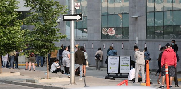 A line up of 60 people that will take 4 hours to get through at the Womens College Hospital COVID-19...