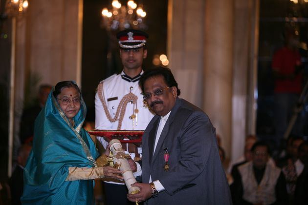 Former President Pratibha Patil presenting the Padma Bhushan to singer SP Balasubrahmanyam during the...