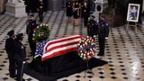 The flag-draped casket of Justice Ruth Bader Ginsburg lies in state at the U.S. Capitol, Friday, Sept. 25, 2020, in Washington. (Olivier Douliery/Pool via AP)
