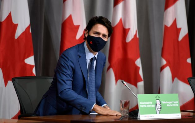 Prime Minister Justin Trudeau responds to a journalist's question as he rises to leave a news conference...