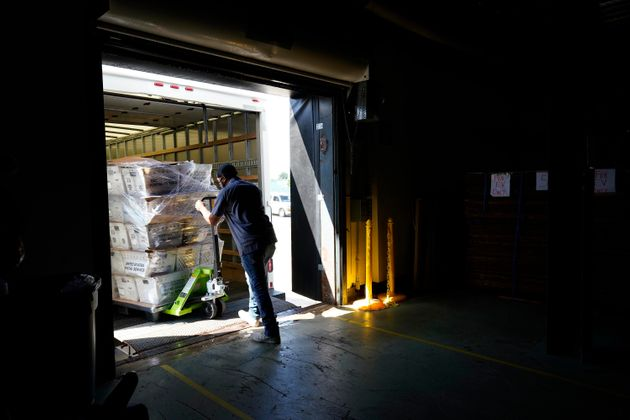 Absentee ballots are loaded onto a truck for mailing at the Wake County Board of Elections as election...