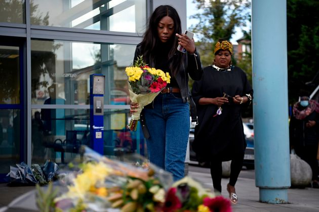 Floral tributes are placed outside the Croydon Custody Centre in south London on September 25,