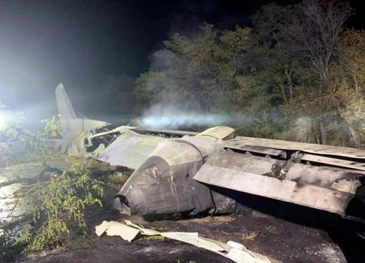 In this photo released by Kharkiv Regional State Administration, wreckage of an AN-26 military plane seen after it crashed in the town of Chuguyiv close to Kharkiv, Ukraine, late Friday, Sept. 25, 2020.