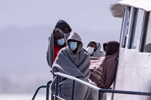 OLBIA, ITALY - SEPTEMBER 25: Migrants wearing protective masks onboard the Alan Kurdi ship of the NGO...