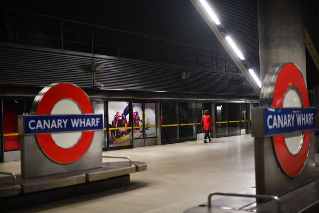 A commuter at Canary Wharf London Underground station, in London, after Prime Minister Boris Johnson...