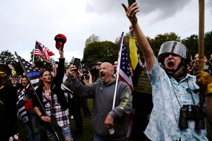 Members of the Proud Boys and other right-wing demonstrators rally on Saturday in Portland, Ore.
