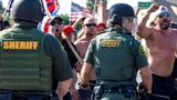Orange County Sheriff deputies keep protesters and counter protesters apart in Yorba Linda, Calif., Saturday, Sept. 26, 2020. Police eventually declared the event an unlawful gathering and cleared the streets near Yorba Linda and Imperial. Authorities said people were struck by a car and injured during the Black Lives Matter protest and counter protest about 30 miles southeast of Los Angeles. Orange County Sheriff's Department spokeswoman Carrie Braun says the injured were transported to a hospital with non-life-threatening injuries and the driver was detained. (Mindy Schauer/The Orange County Register via AP)