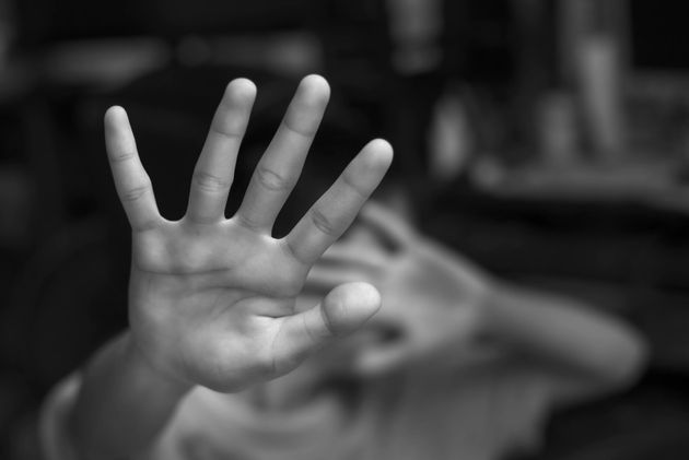Boy showing STOP gesture with his hand. Concept of domestic violence and child abuse. Copy
