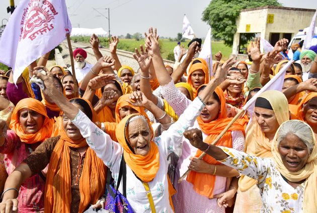 Women raise slogans as they join protesting farmers during the 'Rail Roko' protest against the farm bills,...