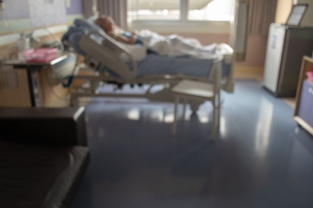blurred image of Patient with drip in hospital for background