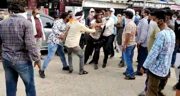 A mob led by local Congress leaders and workers assaulting journalist Kamal Shukla in Kanker district...