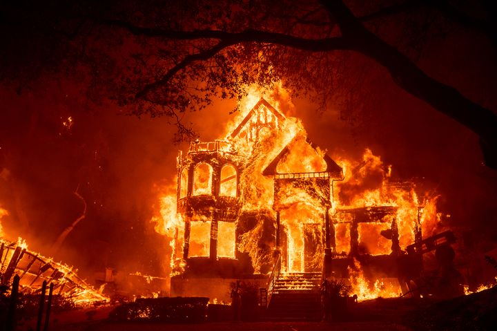 Flames from the Glass Fire consume the Glass Mountain Inn, late Sunday, Sept. 27, 2020, in St. Helena, Calif. (AP Photo/Noah
