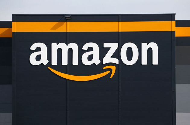 Amazon's logo is seen here at a facility in France on April 21, 2020. The company says it plans to hire...