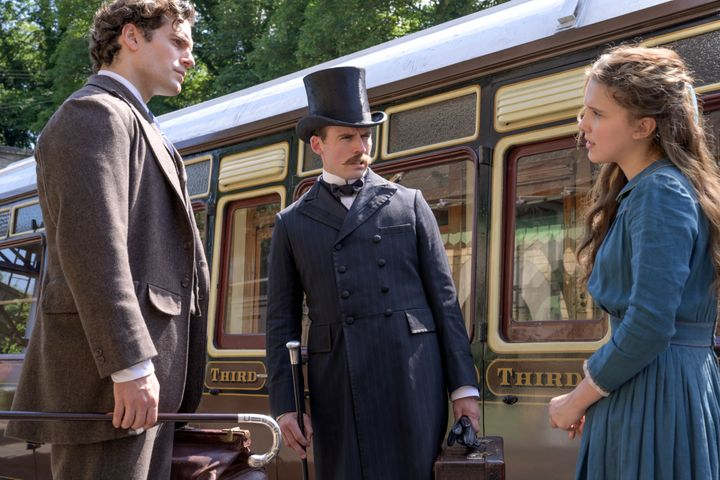 "Actors Henry Cavill, Sam Claflin and Millie Bobby Brown in a scene from ""Enola Holmes"" on Netflix."