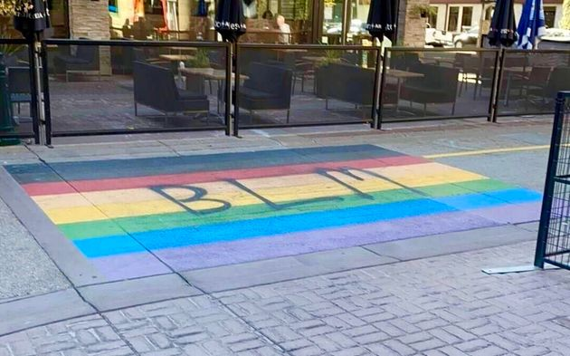 The rainbow crosswalk in Calgary, with BLM spray-painted across