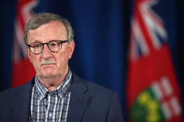 Dr. David Williams, Ontario's chief medical officer of health, listens during a press conference in Toronto...