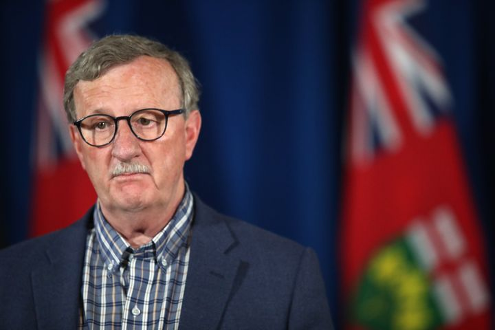 Dr. David Williams, Ontario's chief medical officer of health, listens during a press conference in Toronto on June 23, 2020.