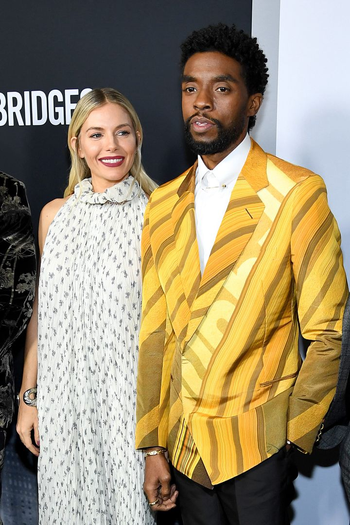 "Sienna Miller and Chadwick Boseman attend a screening of  ""21 Bridges"" in November 2019, in which they both starred. In"