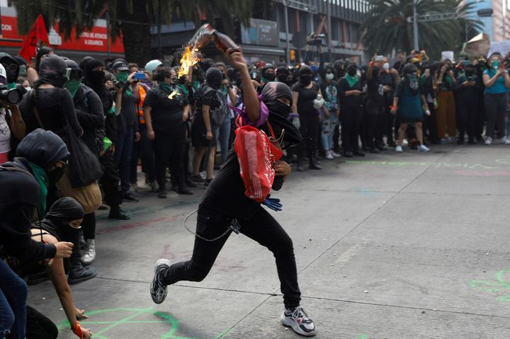 Member of a feminist collective throws a molotov cocktail during a march to mark the International Safe Abortion Day in Mexic