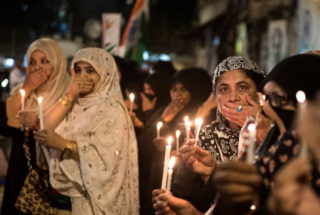 Muslim women protest at a candlelight vigil against Delhi riots at Mumbai Bagh on February 27, 2020 in...