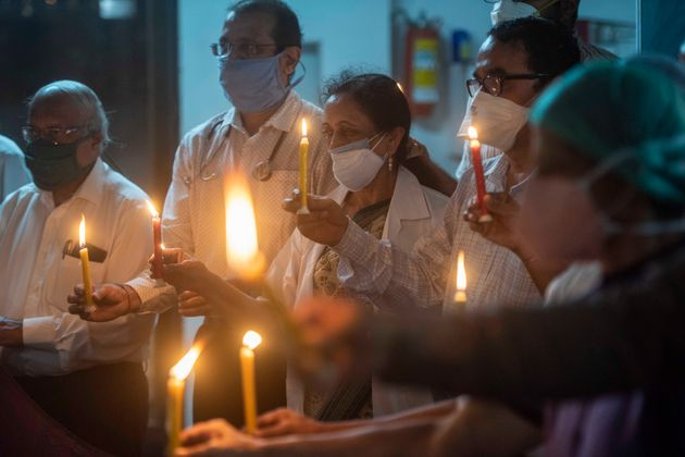 PUNE, INDIA - SEPTEMBER 11: Doctors and members of Indian Medical Association Pune pay tribute by lighting...