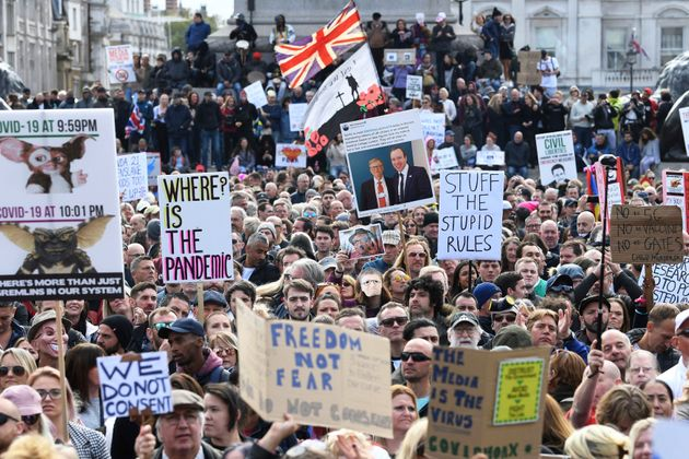 People take part in a 'We Do Not Consent' rally at Trafalgar Square, organised by Stop New Normal, to...