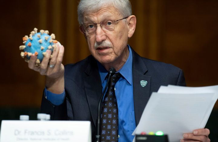 Francis Collins holds up a model of the novel coronavirus during a Senate subcommittee hearing on July 2, 2020, on Capitol Hi