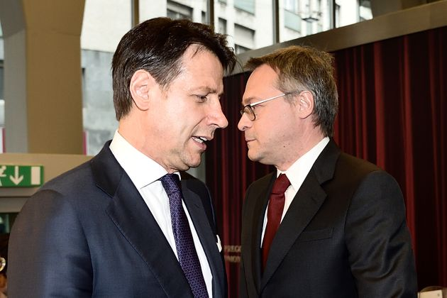 Giuseppe Conte e Carlo Bonomi: non belligeranza