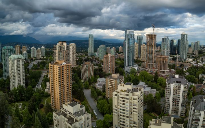 An aerial view of condo towers in the Greater Vancouver neighbourhood of Metrotown. Canada's house prices will keep rising, according to a new forecast from Capital Economics -- but condos might be a different story.