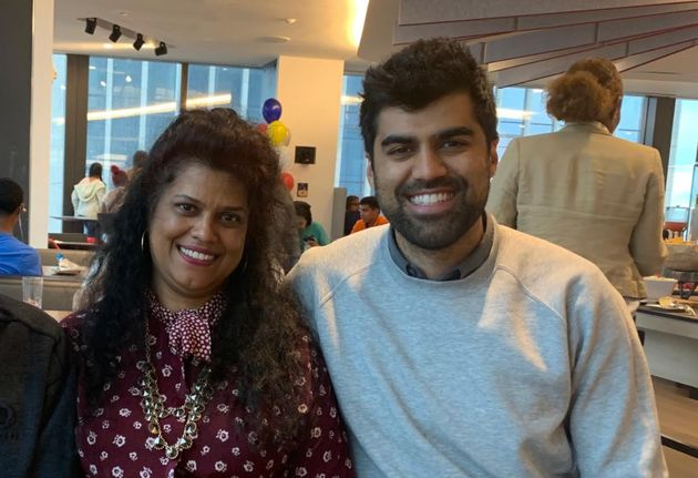 The author with his mom at a family day at the law firm where he worked in New York City in 2019.