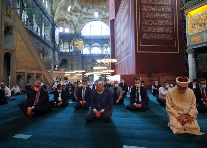 Turkey's President Recep Tayyip Erdogan, center, takes part in Friday prayers inside the Hagia Sophia on Friday, Aug. 7, 2020