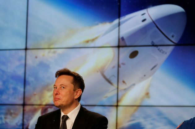 SpaceX founder and chief engineer Elon Musk reacts during a post-launch news conference to discuss the...