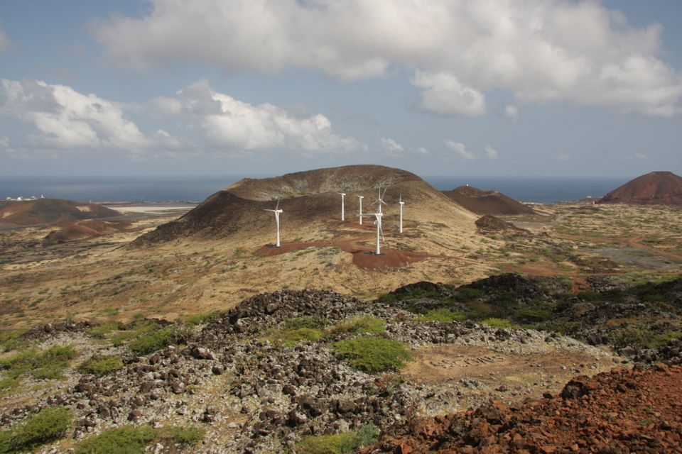 Wind turbines on Ascension Island in South Atlantic Ocean with Wideawake Airfield in background
